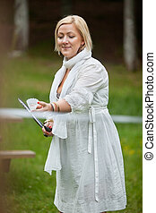 Woman Playing Badminton In Park