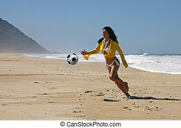 Woman playing ball on the beach