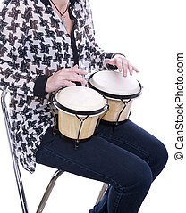 woman playing bongos