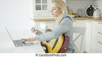 Woman playing electric guitar - Young attractive female...