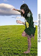 Woman Playing Football - beautiful young woman playing a...