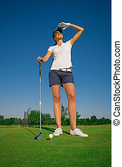 Woman playing golf