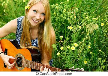 Woman Playing Guitar Outside