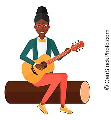 Woman playing guitar.