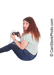 Woman playing her video game.