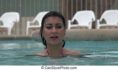 Woman Playing in Swimming Pool