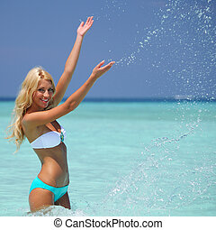woman playing in water - woman  playing in ocean water