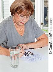 Woman Playing Leisure Games - Senior woman playing leisure...