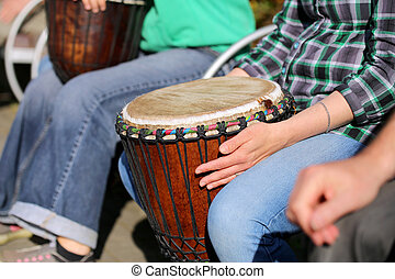woman playing on Africa Jambe Drum
