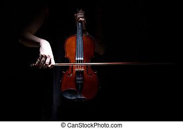 Woman playing on violin
