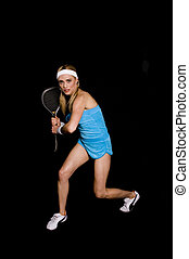 Woman playing raquet ball against a black background