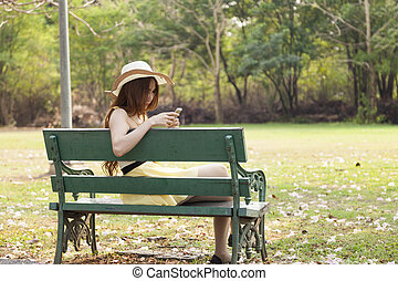 Woman playing smart phone.