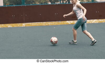 Woman playing soccer football. Female footballe player