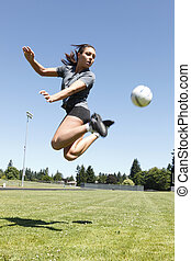 Woman playing soccer