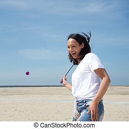 Woman playing tennis at the beach
