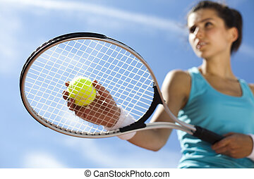 Woman playing tennis - Young woman tennis player on the...