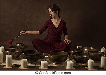 Woman playing Tibetan bowls