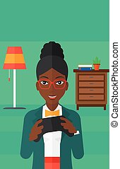 Woman playing video game. - An african-american woman with...