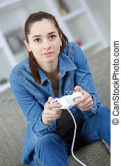 woman playing video game with controller