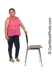 woman playing with a chair in white background,