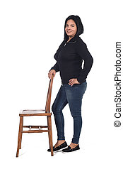 woman playing with a chair in white background