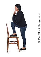 woman playing with a chair in white background,profile hands on chin