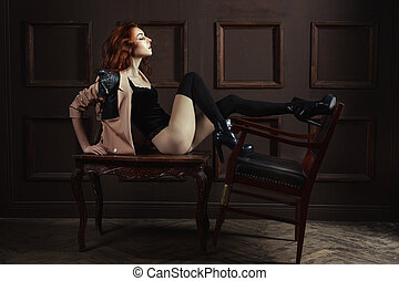 Woman playing with a chair. - Woman playing a chair sitting...