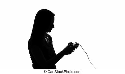Woman playing with a videogame controller