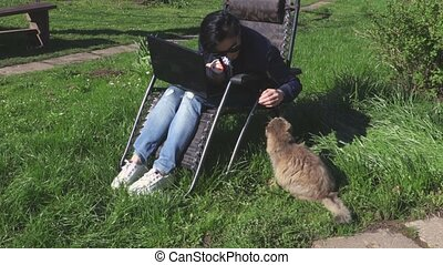 Woman playing with angry cat
