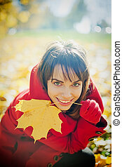 Woman Playing With Autumn Leaf
