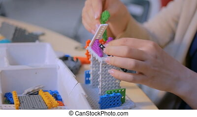 Woman playing with colorful constructor - Close up shot of...