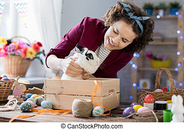Woman Playing with Easter Bunny