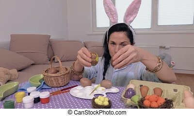 Woman playing with Easter eggs