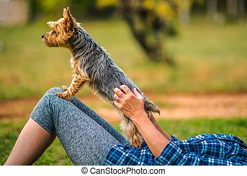 Woman Playing with Her Pet