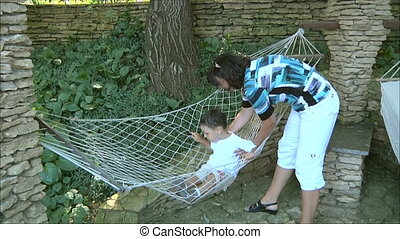 woman playing with his son 2
