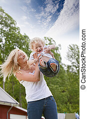 Woman playing with little child