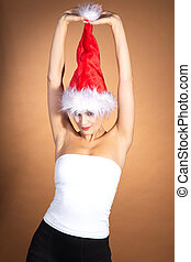 Woman playing with santa hat
