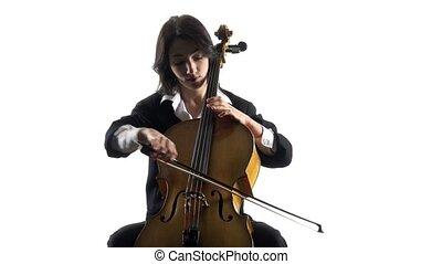 Woman plays a violoncello rehearsing a composition. White...