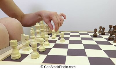 Woman plays chess. focus with moving camera