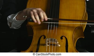 Woman plays the cello professionally classic music. Black...