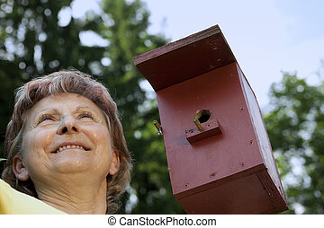 Woman pleased with birdhouses