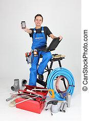 woman plumber showing phone