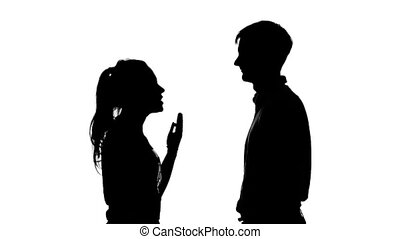 Woman pointing a handgun to a man's temple. Silhouette. White