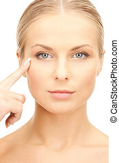 woman pointing at her eye area - face of beautiful woman...
