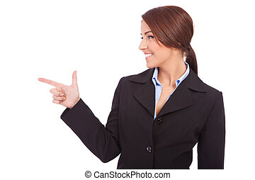 woman pointing at something interesting to her side