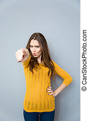 Woman pointing finger at camera - Portrait of a young woman...