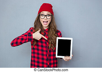 Woman pointing finger on tablet computer screen