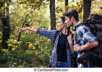 Woman pointing on something to her boyfriend