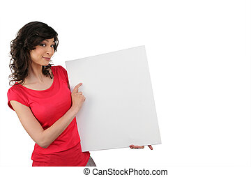 Woman pointing to a blank sign