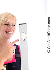 Woman pointing to the bubble in a spirit level